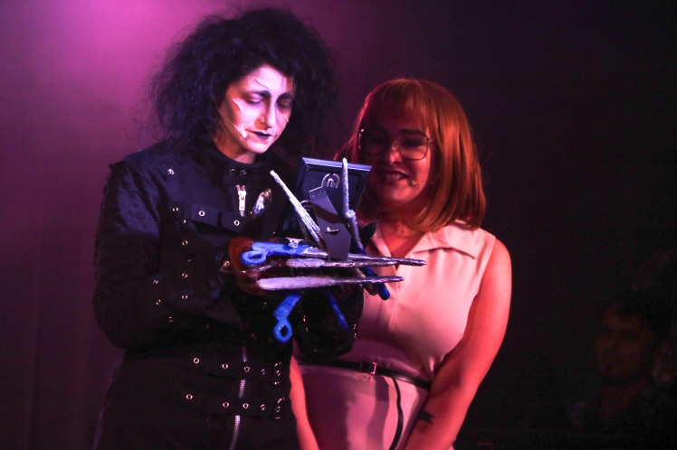 Jordan Kai Burnett as Scissorhands - Emma Hunton as Peg - smirking