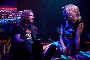 Drew (Ian Ward) and Sherrie (Callandra Olivia) get close in Rock of Ages Hollywood